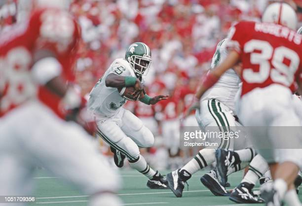 Sedrick Irvin Running Back for Michigan State Spartans runs the ball against the University of Nebraska Cornhuskers during their NCAA Division IA...