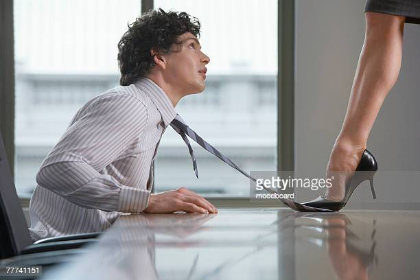 seduction in the workplace - women dominating men stock photos and pictures