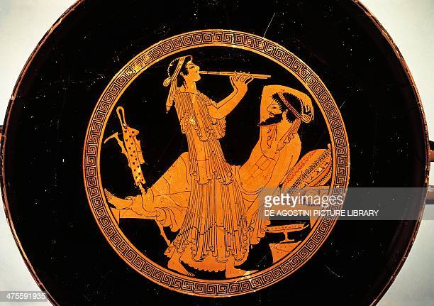 Seduction scene with a banquet and double flute player detail from a kylix or Attic redfigure cup ca 490 BC Colmar Painter terracotta diameter 32 cm...