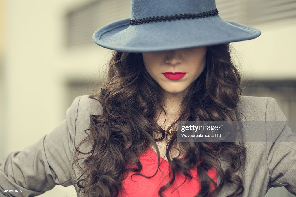 Seductive glamorous brunette wearing stylish clothes posing : ストックフォト