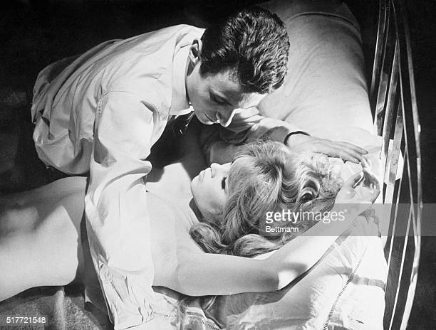A seductive siren if there ever was one French star Brigitte Bardot has Michel Subor under her spell in this provocative scene form her new movie...