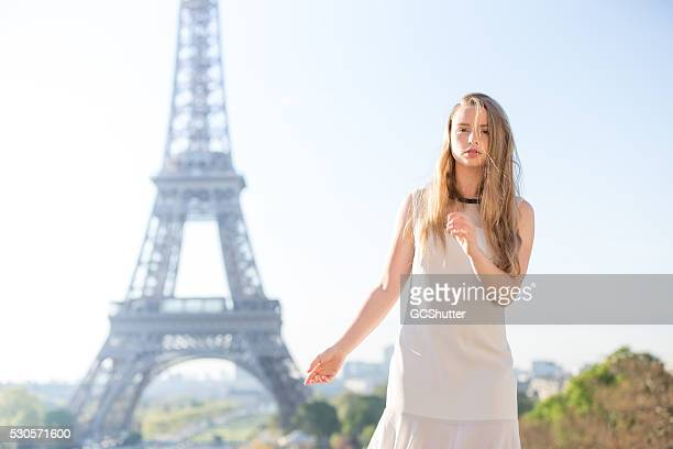 Seductive Woman Gazing, In Front of The Defocused Eiffel Tower