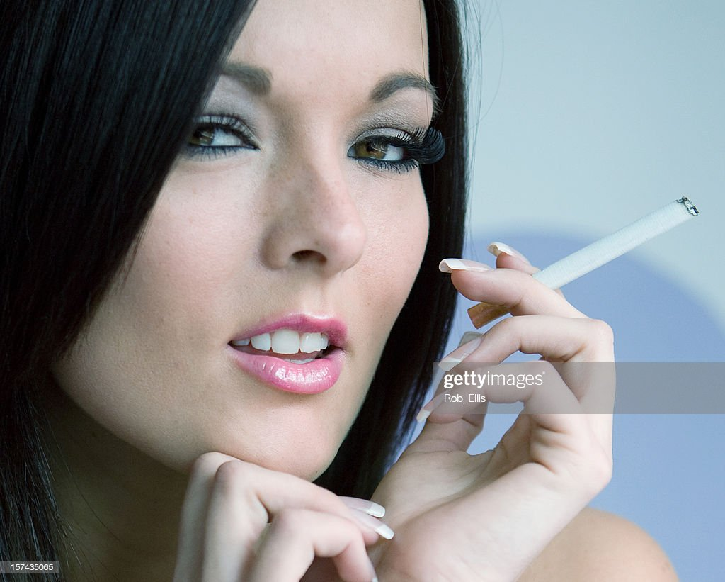 Seductive Woman Smoking Cigarette High-Res Stock Photo - Getty Images