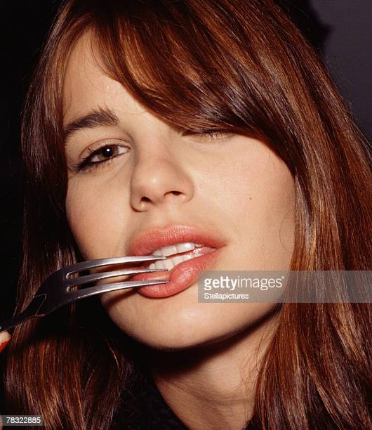 Seductive woman with fork