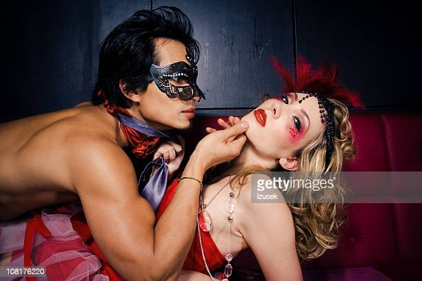 Seductive Young Man and Woman in Costume