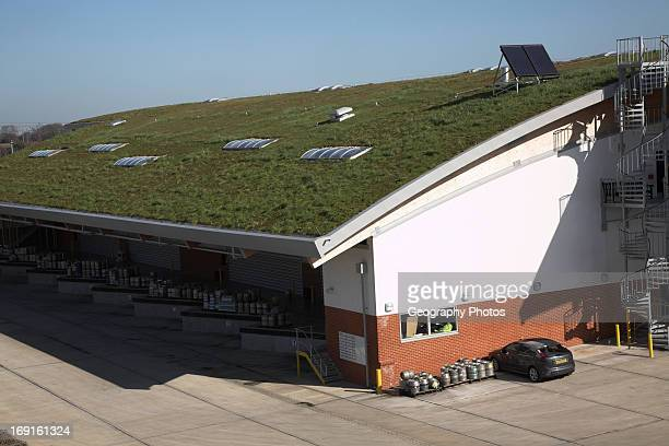 Sedum grass roofing and landscaped surroundings to blend in Adnams brewery distribution center in a rural location at Reydon near Southwold Suffolk...