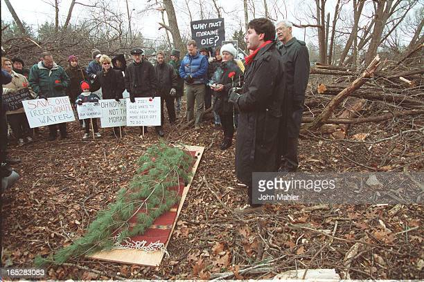 See attached/ Group led by Gloria Marsh marched along road next to construction for widening of Bayview Ave Pall bearers acrried a pine branch to...