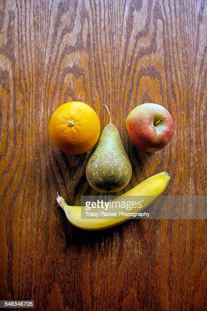 i see faces - navel orange stock photos and pictures