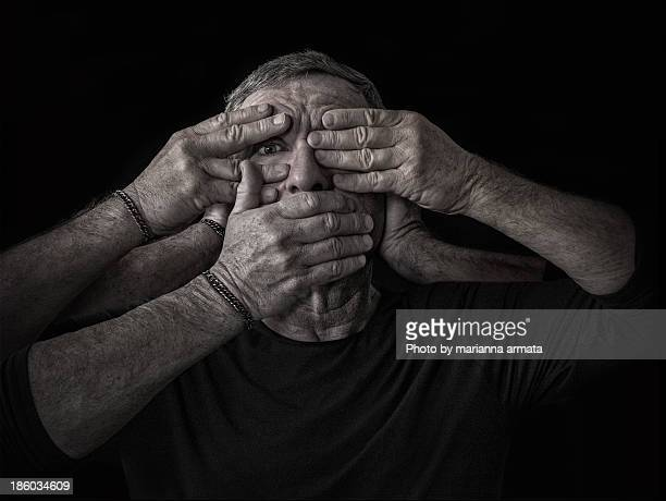 see - hear - speak no evil - hands covering eyes stock pictures, royalty-free photos & images