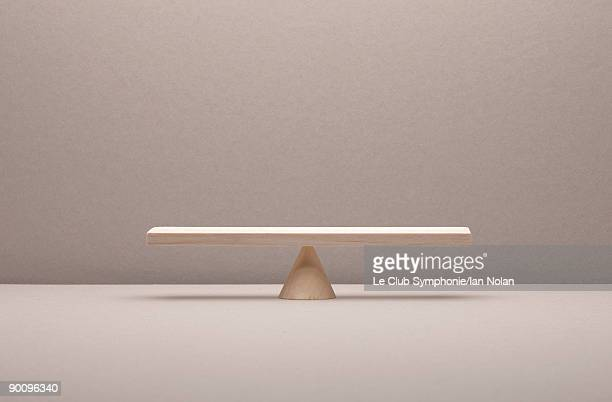 see saw balance made of wood