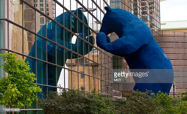I see what you mean a large blue bear sculpture created by Denver artist Lawrence Argent peers into the windows of the Colorado Convention Center on...