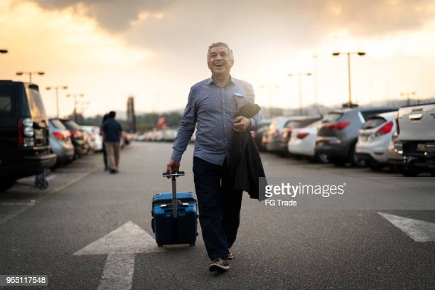 see you next time/ going back home/ business travel - brazilian men stock photos and pictures