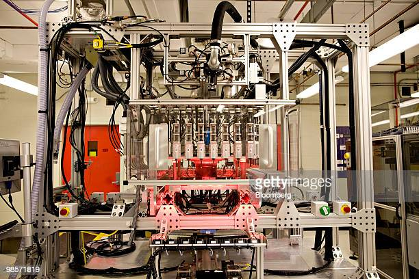 A seed corn chipping machine which removes a small piece of the seed for testing sits inside a Monsanto Co lab in St Louis Missouri US on Thursday...