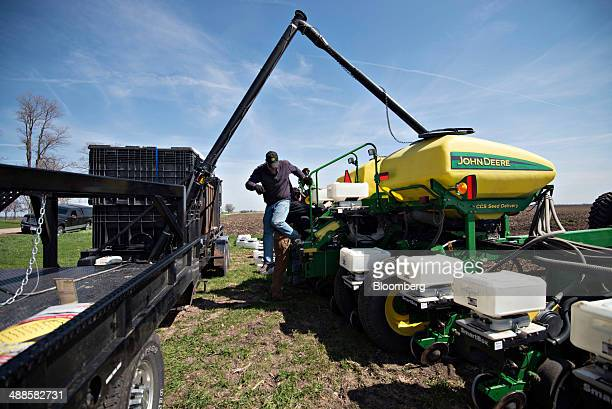 Seed corn is loaded into a Deere Co John Deere 24row planter during planting in Malden Illinois US on Tuesday May 6 2014 This year's record advance...