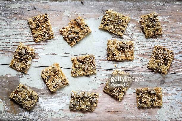 Seed crackers with hemp seeds on wood