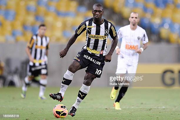 Seedorf of Botafogo struggles for the ball during a match between Botafogo and Atletico MG as part of Brazilian Serie A 2013 at Maracana Stadium on...