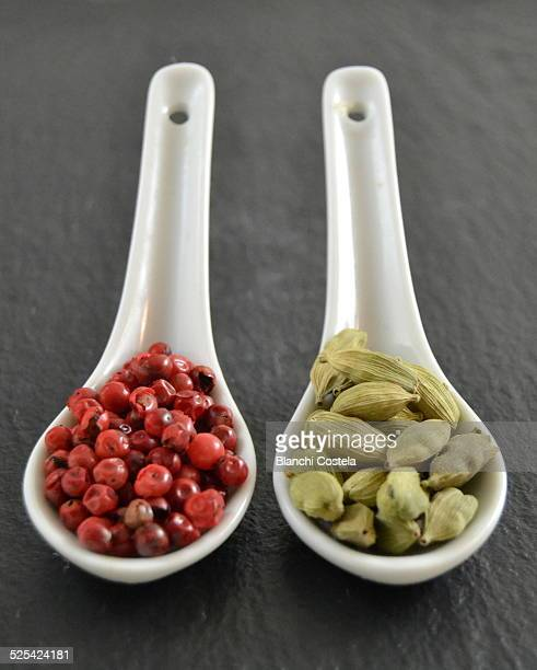 Seeds of cardamom and pink pepper