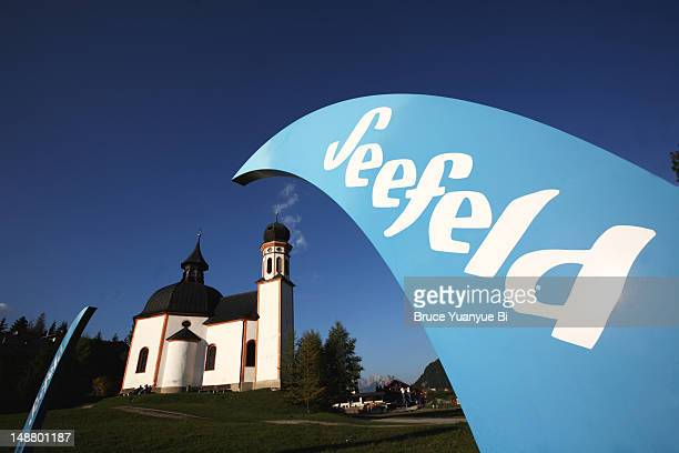 Seefeld sign with historical Seekirchl (Lake Chapel) in background.