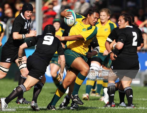 Se'ei Sa'u of Australia is tackled by Emma Jensen of New Zealand during the IRB Women's Rugby World Cup match between New Zealand and Australia at...