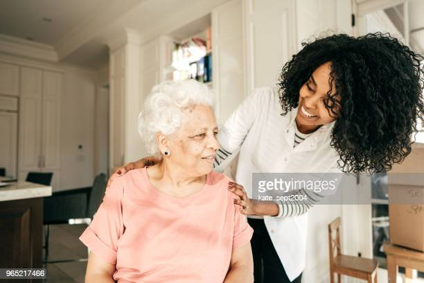 seeing a health professional - nursing assistant stock pictures, royalty-free photos & images