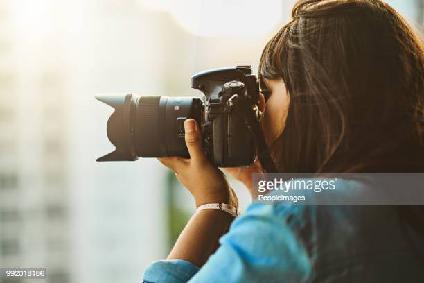 seeing and capturing the world - photographer stock photos and pictures