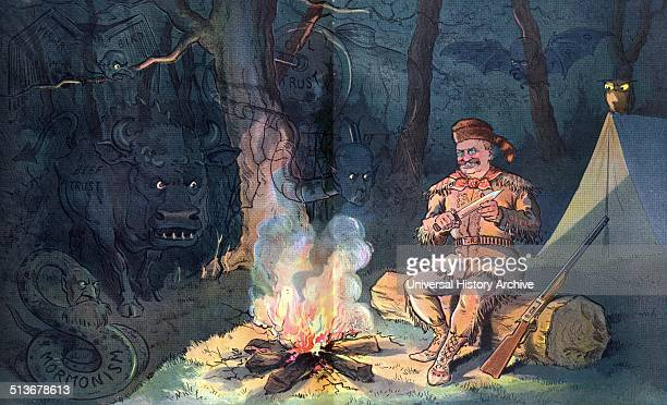 Seeing things at night President Theodore Roosevelt wearing buckskin and raccoon hat sitting by a campfire at night holding a knife his rifle by his...