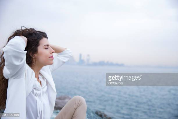seeking zen in the midest of busy and hustled city life - calm before the storm stock pictures, royalty-free photos & images
