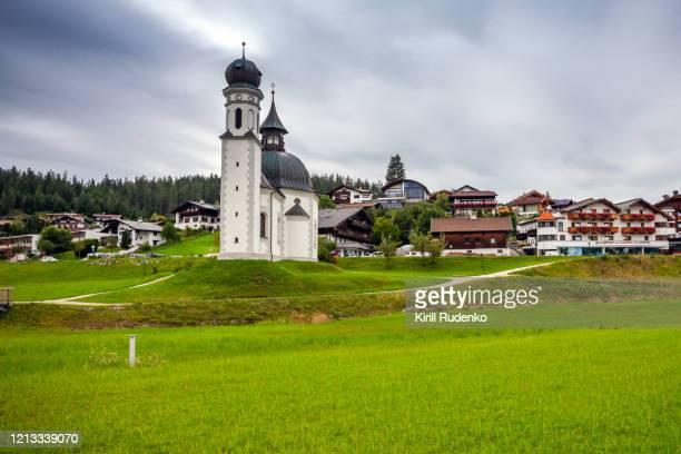 seekirchl church in seefeld in tirol, austria - ゼーフェルト ストックフォトと画像