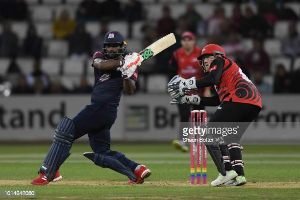 Seekkuge Prasanna of Northamptonshire Steelbacks plays a shot as Stuart Poynter of Durham Jets looks on during the Vitality Blast match between...