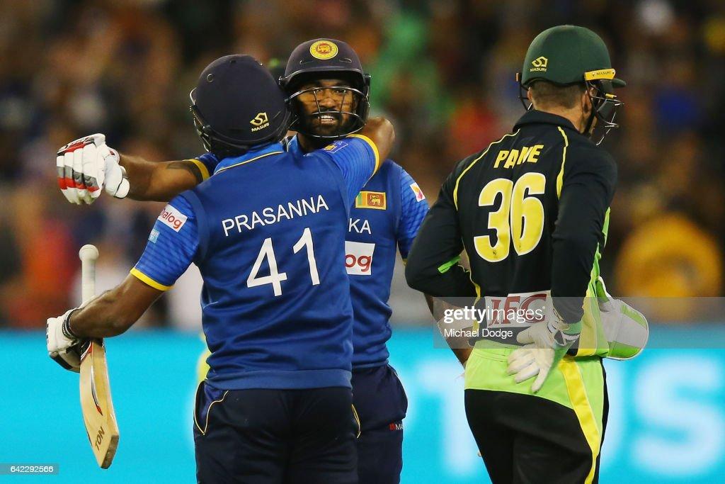 Seekkuge Prasanna of Sri Lanka hugs Chamara Kapugedera after he hit the winning runs during the first International Twenty20 match between Australia and Sri Lanka at Melbourne Cricket Ground on February 17, 2017 in Melbourne, Australia.