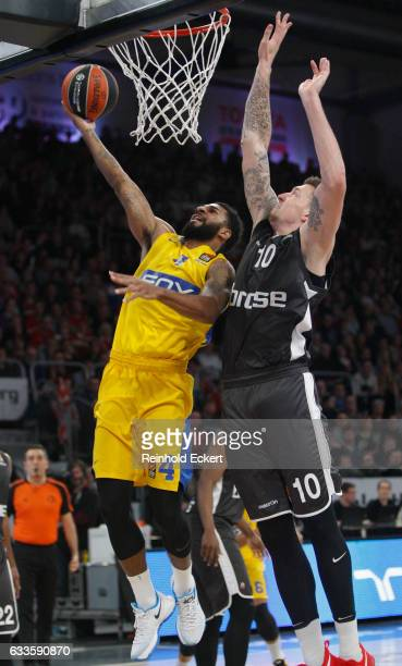 J Seeley #4 of Maccabi Fox Tel Aviv competes with Daniel Theis #10 of Brose Bamberg in action during the 2016/2017 Turkish Airlines EuroLeague...