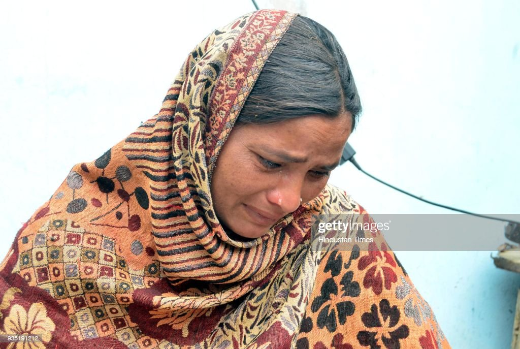 Seema grieving the death of his husband Sonu who was killed in Iraq with Jeeto mother of Sonu at Chawinda Devi Village on March 20 2018 near Amritsar.
