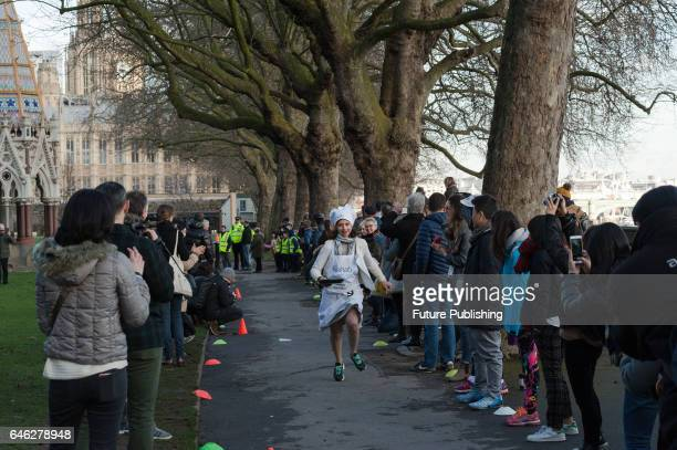 Seema Kennedy MP competes in the 20th Parliamentary Pancake Race on Shrove Tuesday also known as Pancake Day or Fat Tuesday in Victoria Tower Gardens...
