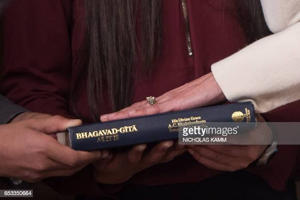 Seema Verma takes the oath as Administrator of the Centers for Medicare and Medicaid Services on the Bhagavad Gita in Washington DC on March 14 2017...