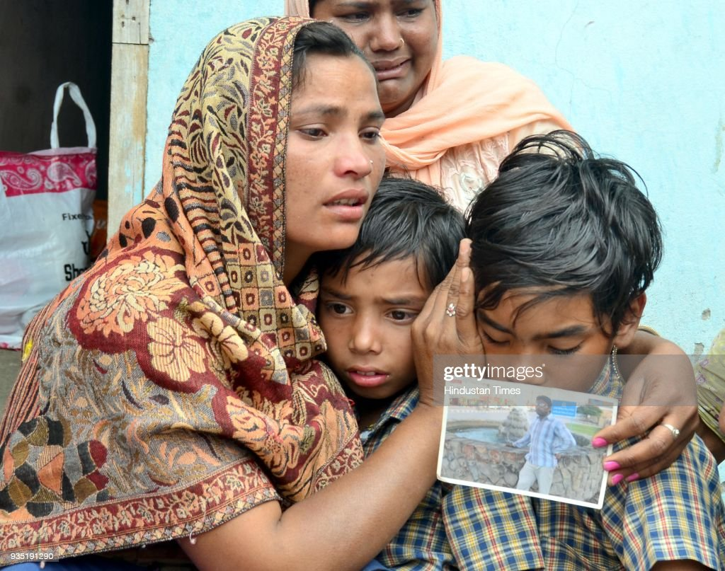 Seema with son Karan and Arjun grieving the death of his husband Sonu who was killed in Iraq with Jeeto mother of Sonu at Chawinda Devi Village on...
