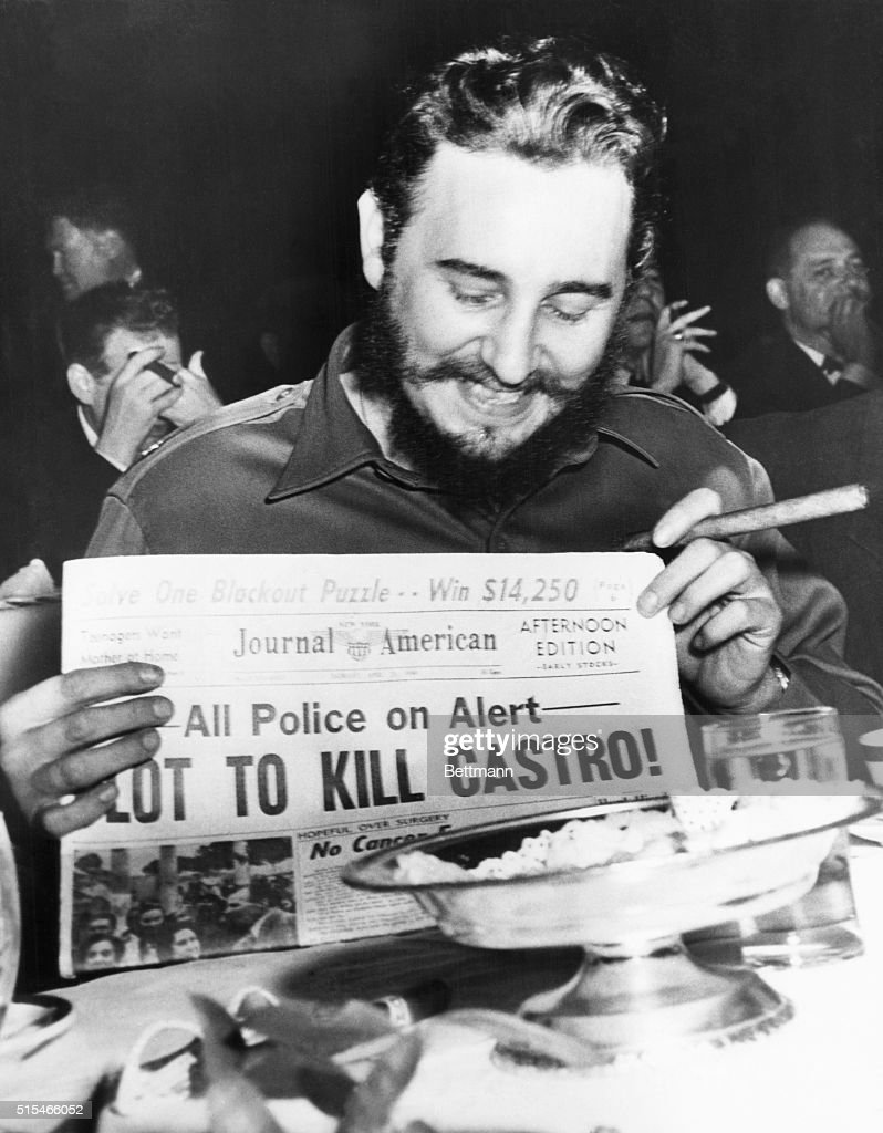 Seems amused by assassination plot...Seeming quite amused, Cuban Prime Minister Fidel Castro holds up a newspaper headlining the discovery of a plot to kill Castro here, April 23rd. Castro was at the Overseas Press Club at the time. Police said five brothers had been sent here from Philadelphia, Pa., to assassinate the bearded leader. Police said that three other men, including a sixth brother, were believed to be in New York in connection with the plot to kill Castro. Earlier in the day, when asked about a reported assassination attempt, Castro had replied, 'In Cuba, they had tanks, planes and they run away. So what are they going to do here? I sleep well and don't worry at all.'