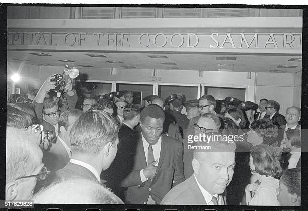 Seen among the crowd outside good Samaritan hospital here June 5th where Senator Robert F Kennedy lies wounded is Rafer Johnson The 1960 Olympic...