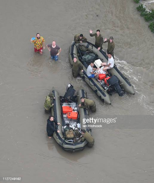 Seen are civillians being assisted by Australian army defence members in the flooded Townsville suburb of Idalia on February 04, 2019 in Townsville,...