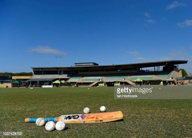 Seen are cricket balls and a bat on the field of play before the start of the JLT One Day Cup match between Queensland and Tasmania at Riverway...