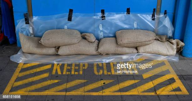 Seen are sandbags placed next to a doorway at the Magnetic Island ferry terminal for protection in preparation for Cyclone Debbie on March 27 2017 in...