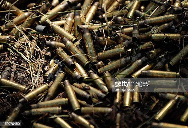 Seen are spent ammunition bullet casings laying on the ground during a live fire excercise on July 31 2013 near Rockhampton Australia Over 30000 US...