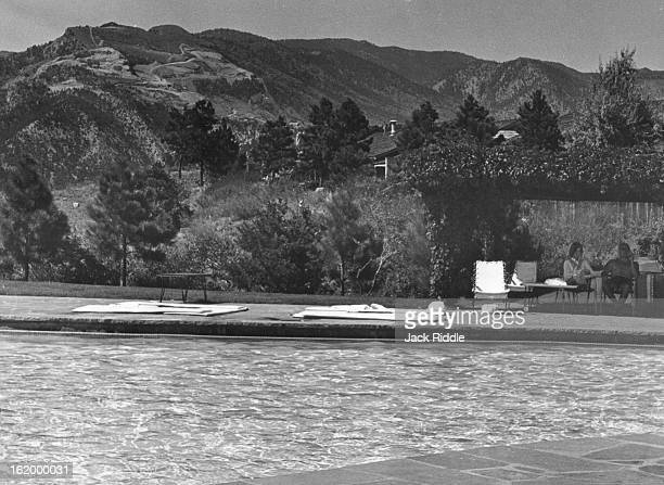 AUG 30 1960 SEP 1 1960 Seen from across the pool of the luxurious Garden of the Gods Club at Colorado Springs is the marred mountainside where the...