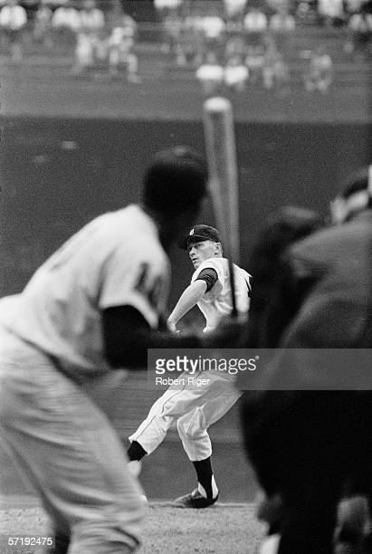 Seen from behind an unidentified batter American baseball player Jim Bunning winds up a pitch during a game at Briggs Stadium Detroit Michigan 1960
