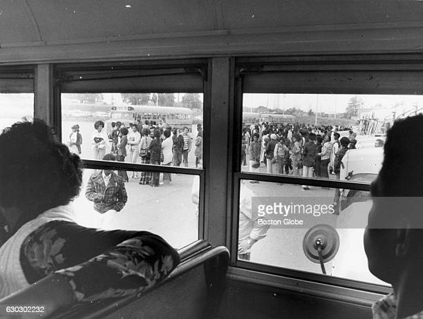 Seen from inside a school bus looking out black students wait for buses for Roxbury on Sept 18 during the first full week of school under the new...