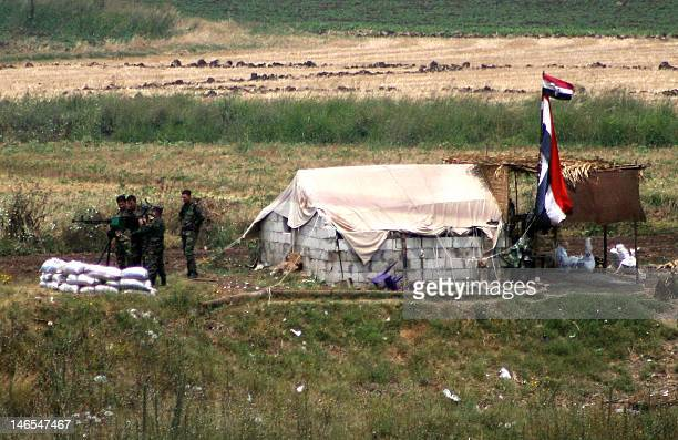 Seen from Lebanon Syrian army soldiers reinforce their outpost with heavy machine guns and artilley close to the Dabusiyeh crossing between northern...