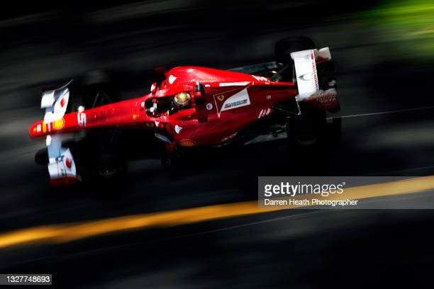 Seen from overhead, Spanish Scuderia Ferrari Formula One racing driver Fernando Alonso driving his F150˚ racing car at speed during practice for the...