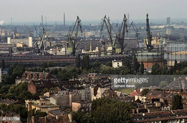 Seen from St Catherine's Church in the old city of Gdansk Poland the famously sprawling shipyard is seen from across the city's old housing and trees...