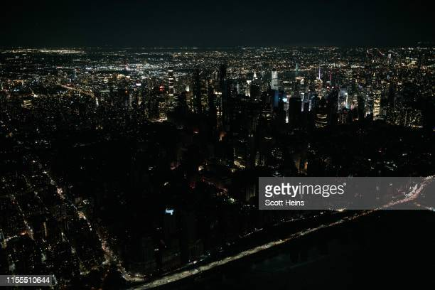 Seen from the air a large section of Manhattan's Upper West Side and Midtown neighborhoods sit coated in darkness during a partial blackout July 13...