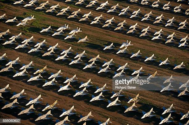 Seen from the air at dawn dozens of F4 Phantom fighters from the Cold Warera are laid out in grids across the arid desert at DavisMonthan Air Forbe...