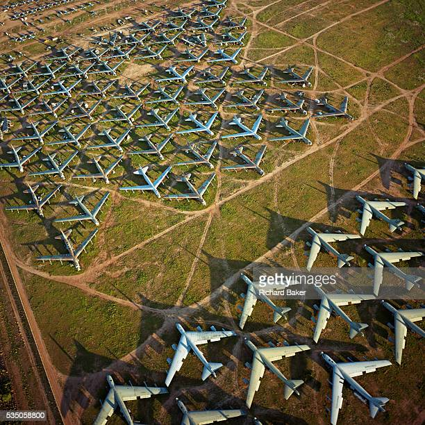Seen from the air at dawn, the last remaining B-52 bombers from the Cold War-era are laid out in grids in their graveyard across the arid desert near...
